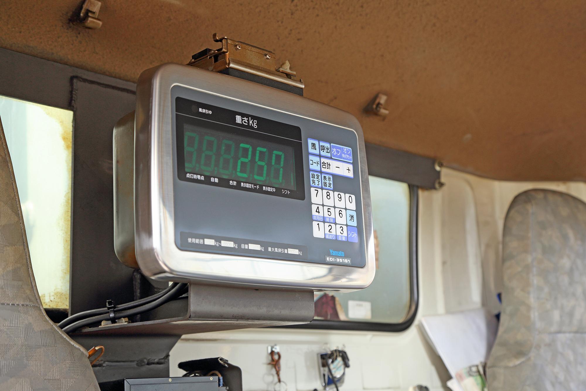 計量器付きパッカー車